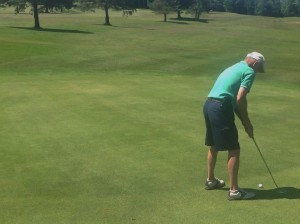 Dave Garland attempting a 40 foot putt for $2,500.